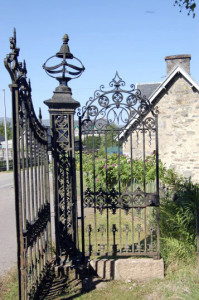 These iron gates once stood in front of the mansion. They  now mark the entrance to several historical buildings renovated as Tomich Holidays.
